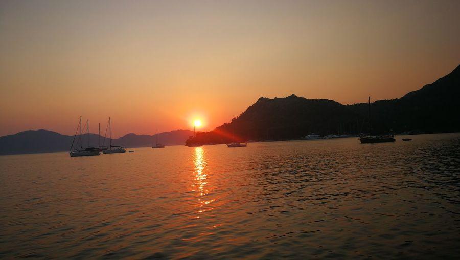 EyeEm Selects Water Nautical Vessel Sea Mountain Sunset Beach Sand Sun Awe Refraction