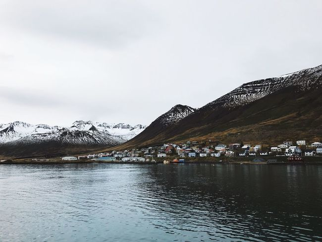 Quiet town Mountain Cold Temperature Beauty In Nature Winter Sky Nature Water Snow Tranquility Mountain Range Lake Scenics Tranquil Scene Waterfront Outdoors Snowcapped Mountain Frozen No People Day Landscape IPhoneography IPhone The Week On EyeEm Iceland Wave