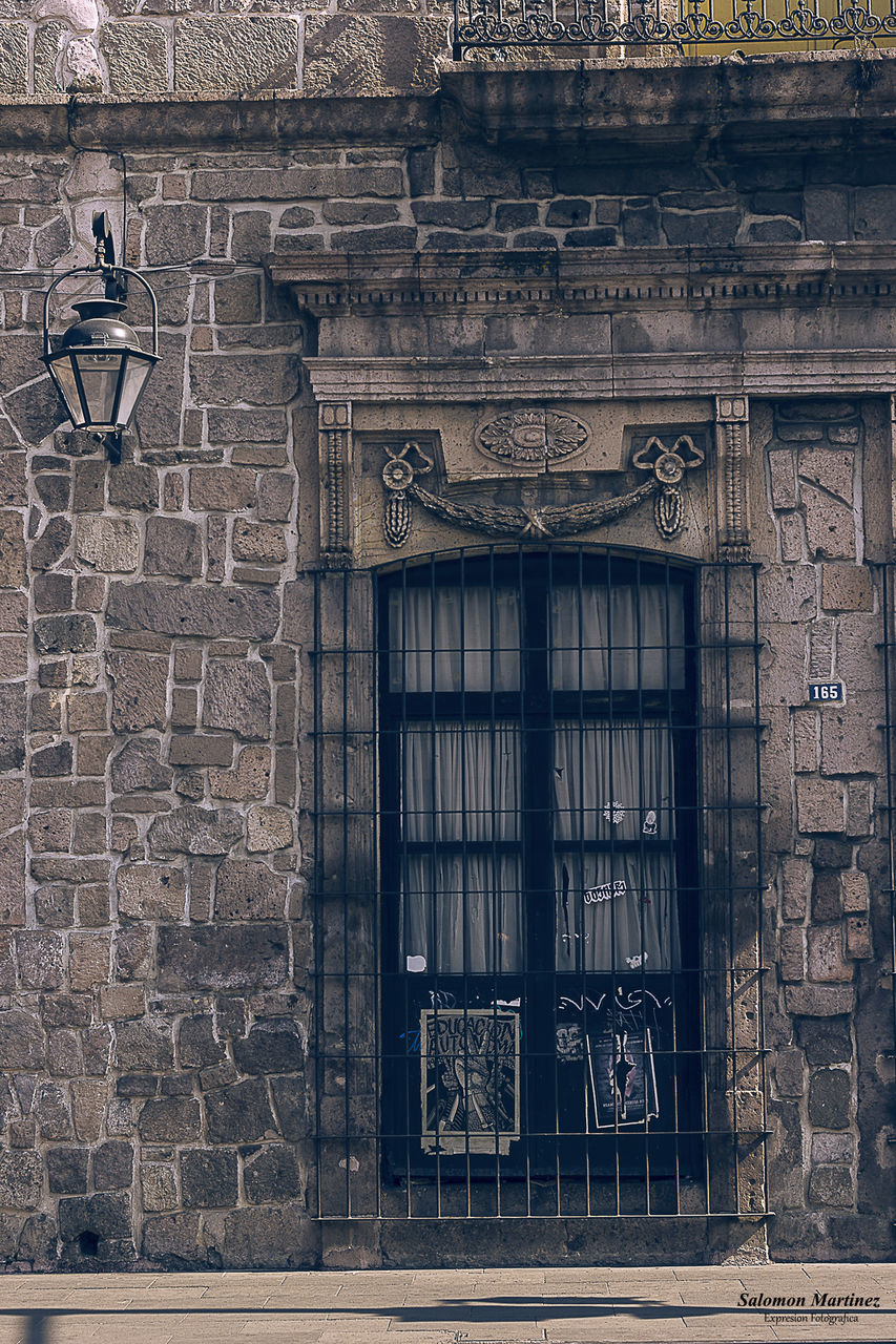 architecture, built structure, brick, building exterior, brick wall, wall, no people, history, building, the past, window, day, wall - building feature, art and craft, low angle view, old, outdoors, creativity, travel destinations, craft, stone wall