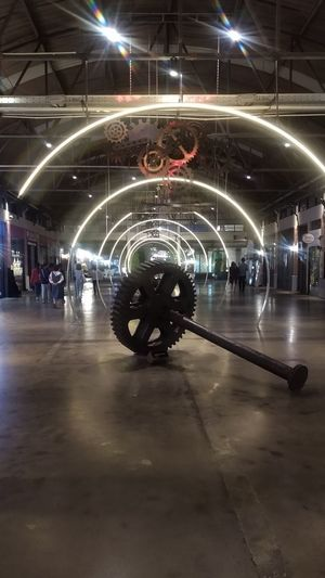 Blurred motion of people at illuminated subway station