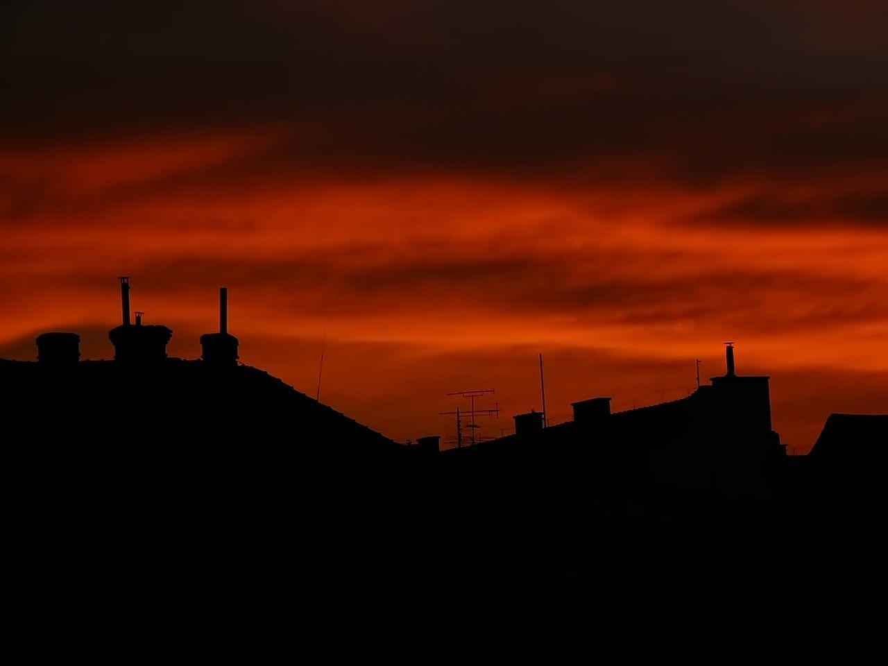 Silhouette Houses Against Orange Sky