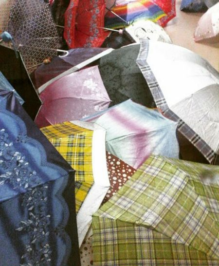 Umbrella Rainy Days Mess Up Retail  Textile Variation Business Finance And Industry Market Multi Colored Outdoors