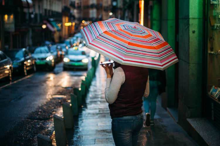 woman with umbrella speaking to the phone on rainy afternoon Afternoon Calling Dark Madrid Mobile Phone Out Of Focus SPAIN Street Light Bokeh Call City Conversation Focus On Foreground Footpath Holding Night One Person Outdoors Phone Protection Rain Rainy Season Real People Street Umbrella The Street Photographer - 2018 EyeEm Awards EyeEmNewHere Autumn Mood Capture Tomorrow