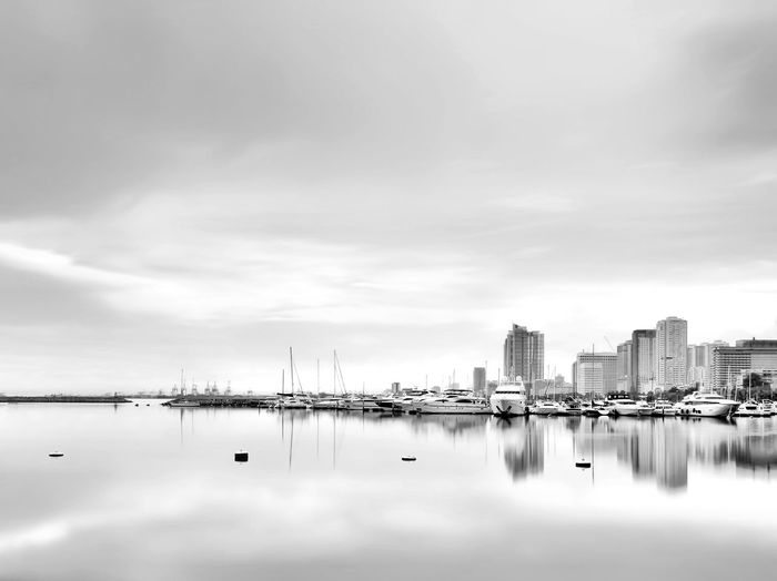 Manila Classic EyeEmNewHere Travel Destinations Travel Tourism Boat Yatch Long Exposure Blackandwhite Black And White Photography Monochrome High Key Buildings Seascape Cloudy Reflection Skyscraper Cloud - Sky Sky No People Cityscape City Water Day