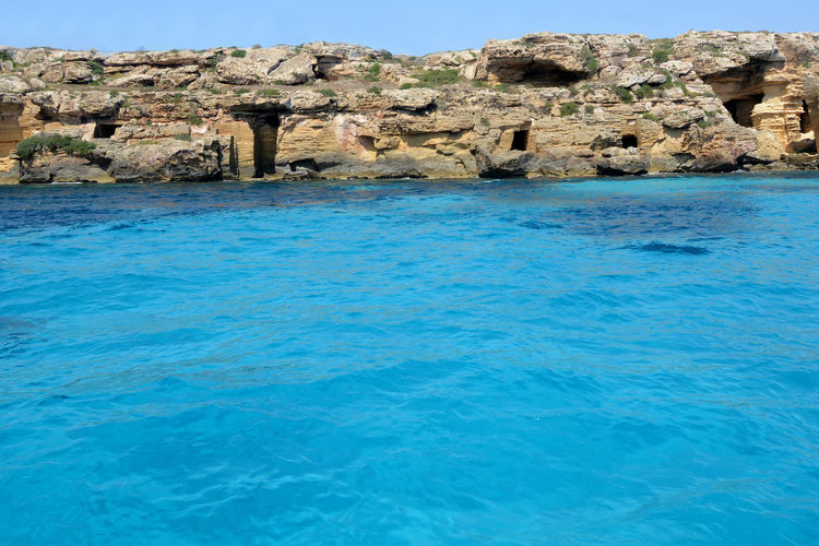 The island of Favignana is part of the Egadi archipelago in Sicily in front of Trapani. In Italy the Mediterranean sea is blue with beautiful reflections. Favignana's Sea Sicily ❤️❤️❤️ Beauty In Nature Blue Egadi Egadi Islands Favignana Idyllic Nature No People Rock Rock - Object Rock Formation Scenics - Nature Sea Sicily Landscape Sky Tranquil Scene Tranquility Turquoise Colored Water Watercolor Watercolors  Watercolours Waterfront