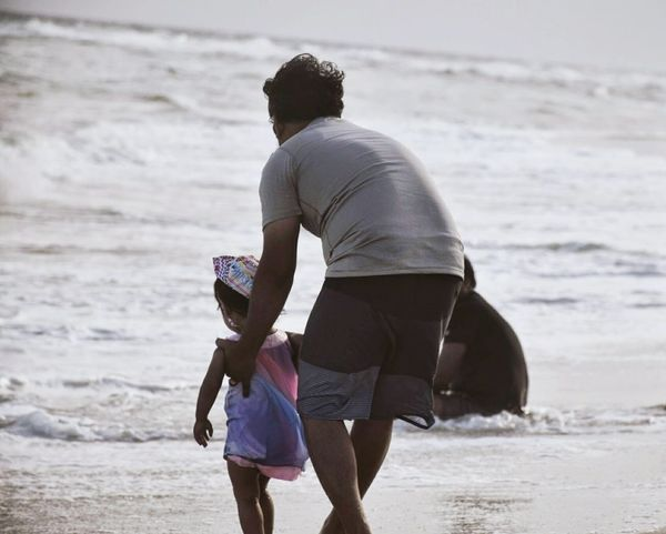 Daughter seeing first time beach Beach Sea Casual Clothing Sand Two People Vacations Summer Travel Walking Leisure Activity Happiness Togetherness Taking Care Father And Daughter Windy Sunset Caring Live For The Story