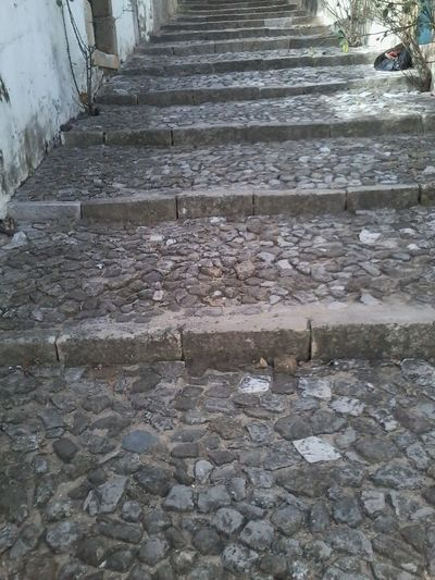 Calçada na Vila Alta de Alenquer -Portugal Architecture Day In A Row Long Moving Up No People Stairs Steps Steps And Staircases Stone Stone - Material