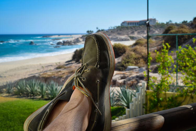 Finally relaxing in paradise. Adult Beach Boat Shoes Close-up Day Nature One Person Outdoors People Relaxing Relaxing Outdoors Sea Shoes Sky Art Is Everywhere The Great Outdoors - 2017 EyeEm Awards