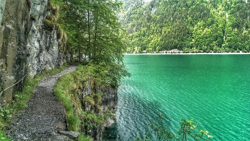 Hiking at Klöntalersee in the mountains Switzerland Nature Rockfaces Hiking Lake View Landscape Green Beautiful Day Mountain Lake The Great Outdoors - 2017 EyeEm Awards