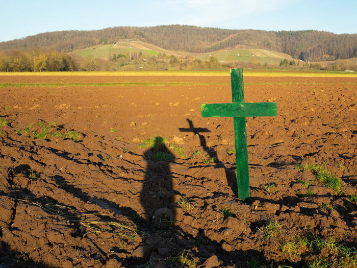 Shadow of cross on land