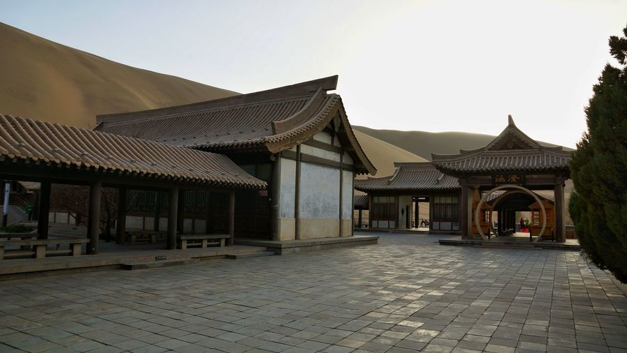 GobiDesert Architecture Built Structure Travel Destinations Outdoors DunHuang Landmark National Park Tourism China,Guizhou Ancient Nature Ancient Building Sand Dune Background Cresent Lake