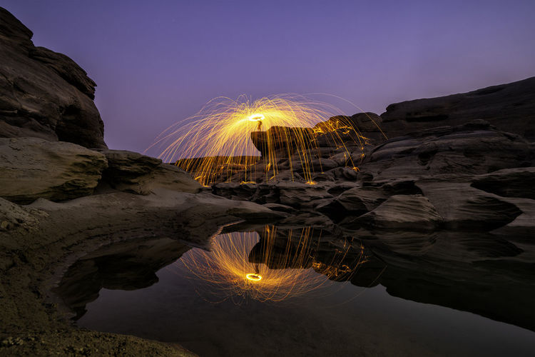 Reflection of Light painting at Sam Pan Bok the Grand Canyon in Thailand, Ubon Ratchathani Reflection Light Motion Wire Wool Night Long Exposure Nature Illuminated Outdoors Painting Rock Water Landscape Summer Twilight Explore Mirror, Mirror Vivid Hilltop Sunset Shape Curve Art