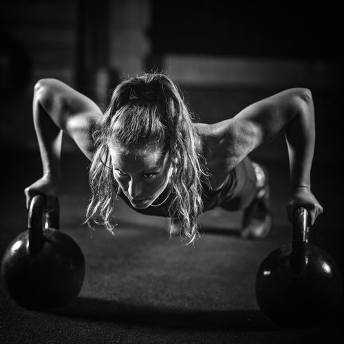 Young Woman Exercising At Gym