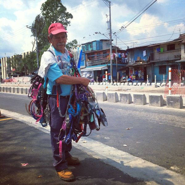 Photojournalism IPhoneography Eye4photography Streetphotography Miguel Angel a #streetvendor starts his day at the crack of #dawn to start walking the streets of #sansalvador selling keychains, flutes, #dog leashes and other small items. He used to have a small #makeshift shop in downtown but it was shut down by local officials and now makes a living selling on the streets earning between $3 to $7 a day roaming the capital city until night fall. From that gross he has to feed himself through out the day leaving him with a very small profit. / Miguel Angel es un #vendedor #ambulante quien inicia su dia al amanecer para caminar las calles de San Salvador vendiendo llaveros, flautas, correas para perros y otros objetos . Antes el tenia in puesto en las calles del centro pero fue clausurado por el gobierno local, hoy en dia se gana su #pandecadadia vendiendo en las calles ganando entre $3 a $7 al dia recorriendo las calles de la ciudad capital hasta el anochecer. De estas ganancias el tiene que alimentarce a traves del dia dejandole poca ganancia. #centralamerica #dailylife #photojournalism #aphotoaday @openshowsf @openshow #iphoneography #aviary #photooftheday #latinamerica #eye4photography #juancarlos #2014copyright