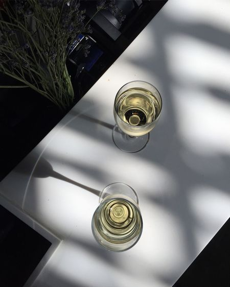 High angle view of glass bottle on table