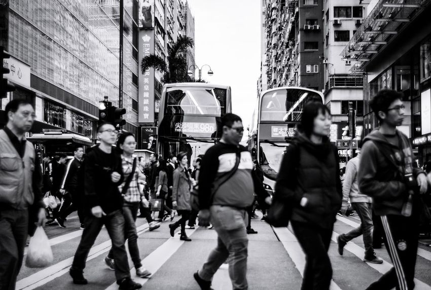 Hkbw Reframinghk Street Photography Discoverhongkong City Architecture Building Exterior Built Structure Group Of People Large Group Of People Crowd Street Real People City Street Transportation City Life Walking Men Adult Women Day Outdoors Mode Of Transportation Lifestyles