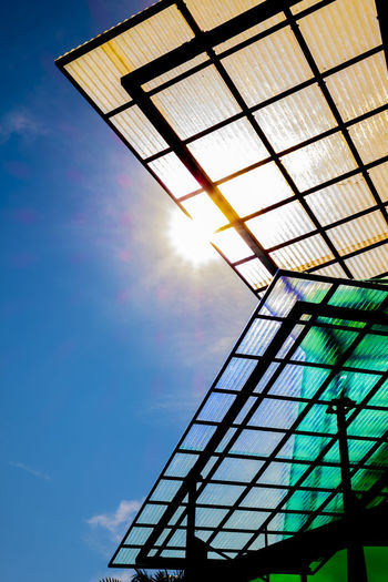 Modern Roof. Creativity Modern Shape Architecture Brightly Lit Building Exterior Built Structure Day Design Glass Glass - Material Lens Flare Low Angle View Metal No People Outdoors Pattern Shapes And Forms Shapes And Patterns  Sky Solar Flare Sun Sunbeam Sunlight