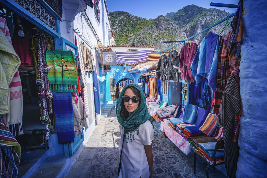 """The Blue City"" - Chefchaouen, Morocco. Chefchaouen Chefchaouen Medina Medina Morocco MoroccoTrip EyeEmNewHere a new beginning Digital Nomad Travel Travel Destinations Traveling Travel Photography Photography Blue City Alley Maze Arabic Moroccans Tourism Tourist Attraction  Tourist Destination One Person Standing Portrait Young Adult Front View Looking At Camera Real People Clothing Casual Clothing Lifestyles Adult Leisure Activity Young Women Day Women Waist Up Market Retail  Three Quarter Length Outdoors"