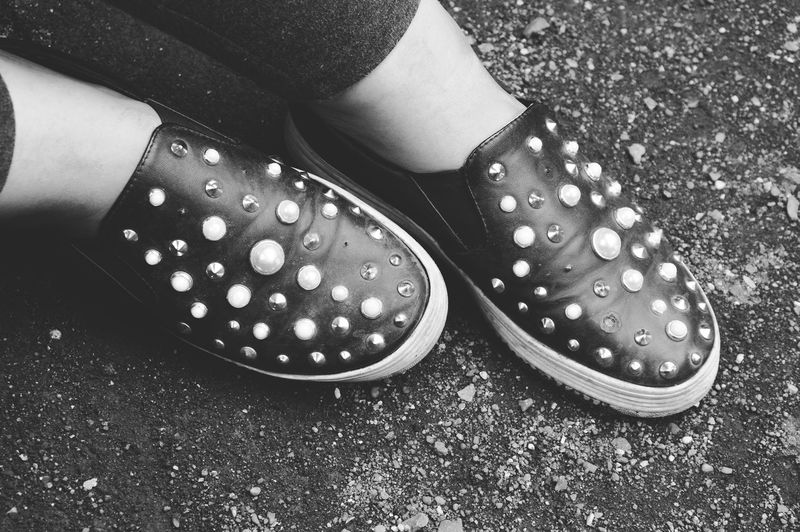 Black shoes with white beads and spikes