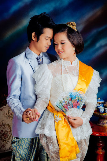 Loving young couple wearing traditional clothing