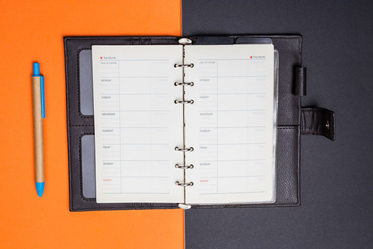 Indoors  No People Close-up Still Life Communication Directly Above Paper Orange Color Technology Pen Number Calendar Page High Angle View Wall - Building Feature White Color Note Pad Office Supply Office Red Blank Personal Accessory