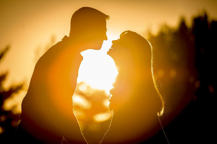 Beauty In Nature Bonding Couple - Relationship Heterosexual Couple Kiss Love Love Lovely Outdoors Silhouette Sunset Togetherness Two People