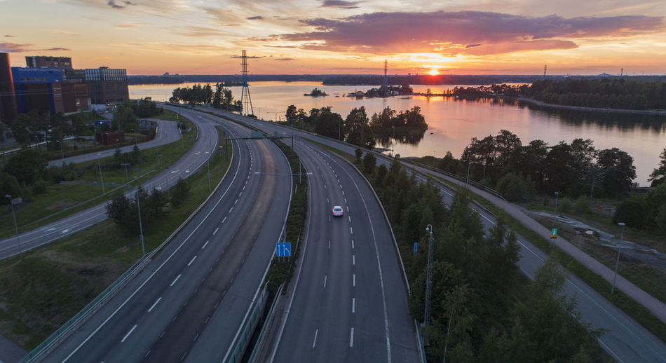 High angle view of highway in city during sunset