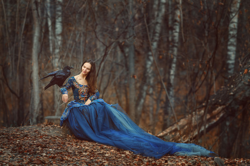 Woman sitting in forest