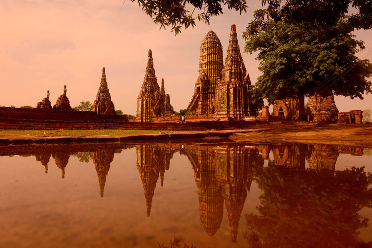 Historic temple reflecting in water