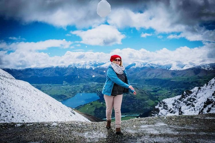 Front view of woman walking on mountain