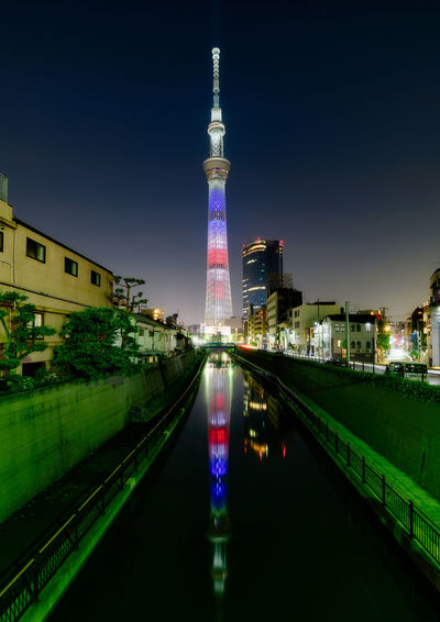 Illuminated tokyo sky tree in city at night