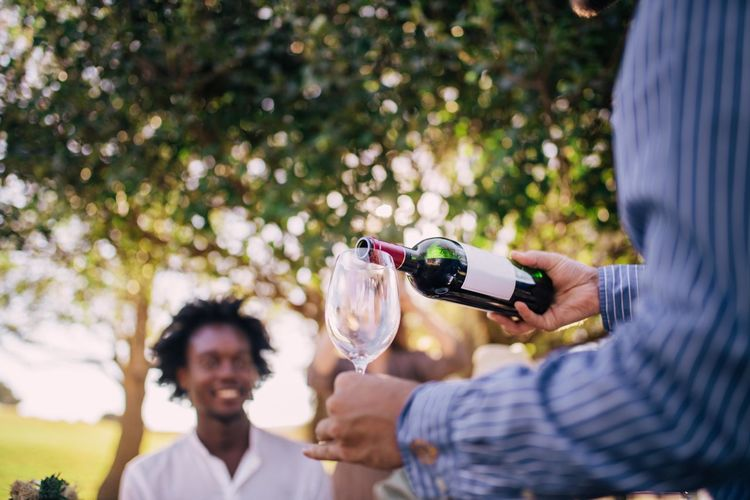 Holding Two People Men Adult Males  Togetherness Alcohol Mid Adult Portrait Emotion Leisure Activity Wine Focus On Foreground Young Men Day People Mid Adult Men Casual Clothing Real People Positive Emotion Outdoors Glass Mature Men Celebration Social Gathering