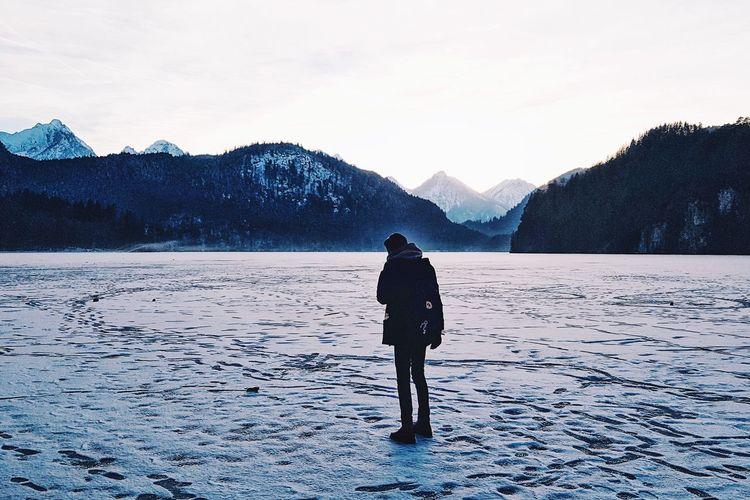 Full Length Of Man On Frozen Lake Against Sky