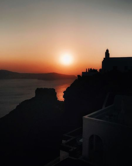 Sunset Architecture Silhouette Built Structure Building Exterior Sea Outdoors No People Nature Sky Sun Water Scenics Beauty In Nature Clear Sky Day Church Orthodox Church Santorini People