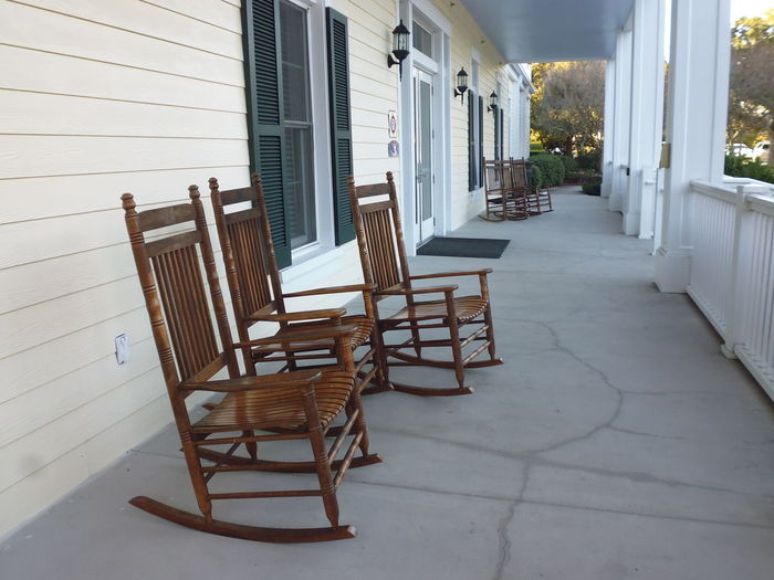 Empty chairs and tables at porch