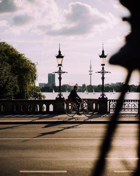 Biker vs sun Cloud - Sky No People Day Hamburgliebe Architecture Hamburg Outdoors