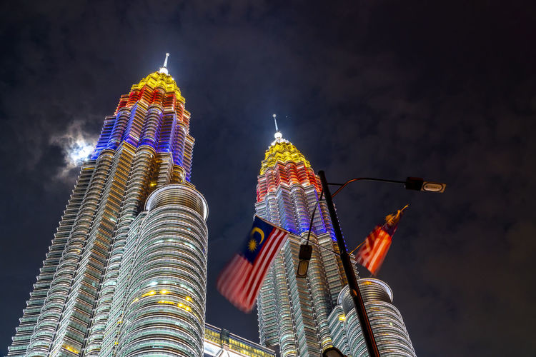 Klcc twin tower lighted up with beautiful national flag colours celebrating independence day