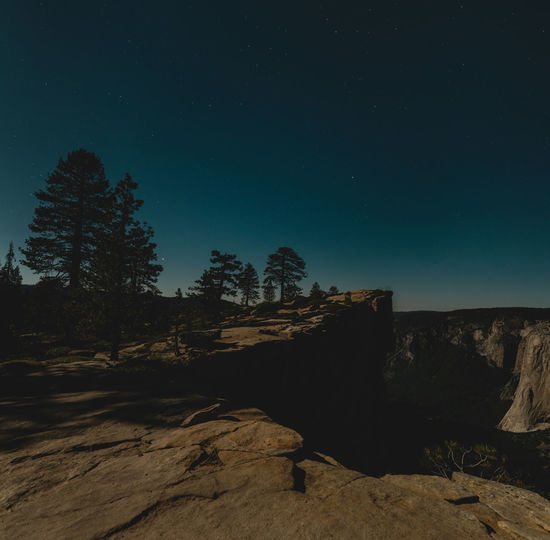 Longtime exposure night shot during full moon overlooking Taft Point, Yosemite National Park, California, USA. Formation Outdoors Non-urban Scene Rock Formation No People Rock - Object Night Rock Tree Mountain Nightscape Night Sky Night Photography Longtime Exposure Wide Angle High Resolution Moonlight Mysterious Yosemite National Park Hikingadventures Taft Point Cliff Edge Viewpoint Profile Rock