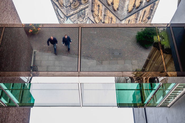 upside down in Bremen   Germany Adult Adults Only Architecture Bridge Bridge - Man Made Structure Building Exterior Built Structure Church Day Glass Glass - Material Indoors  Men Mirror Mirrored Mirrored Reflection Modern People Real People Reflection Sky Street Streetphotography Togetherness Window