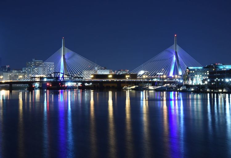 Illuminated Leonard P Zakim Bunker Hill Bridge Over Charles River At Night