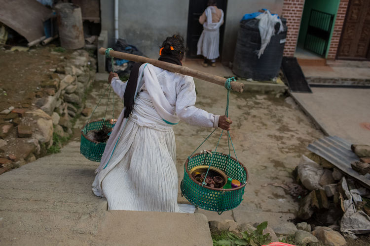 High angle view of people working in basket