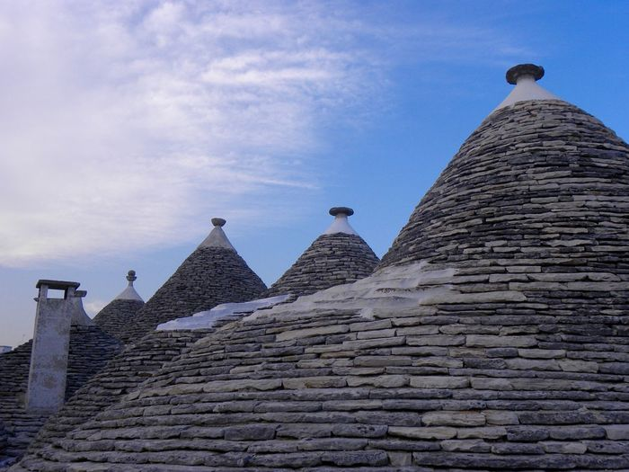 Alberobello Alberobello - Puglia Alberobello City Alberobelloexperience Alberobellophotocontest Ancient Ancient Civilization Animal Themes Architecture Building Exterior Built Structure Day History Low Angle View No People Old Ruin Outdoors Pyramid Sky The Past Travel Destinations Your Ticket To Europe