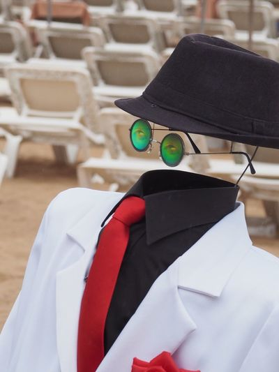 Invisible man wearing hat and tie