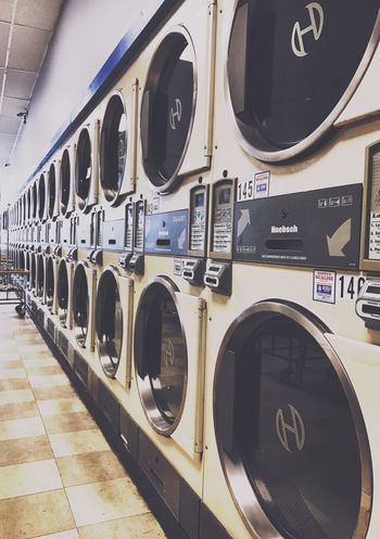 Washing Machine Laundromat Laundry Machinery Indoors  In A Row No People Dryer  Close-up Day Dryers Urban Vintage Look Yellow Color Doing Laundry Machine Machines Tumble Dryer 50's Style Perspective Shapes Convenience