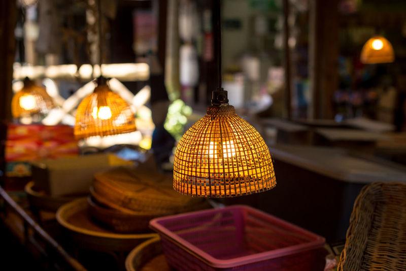 Close-up of illuminated lantern on table
