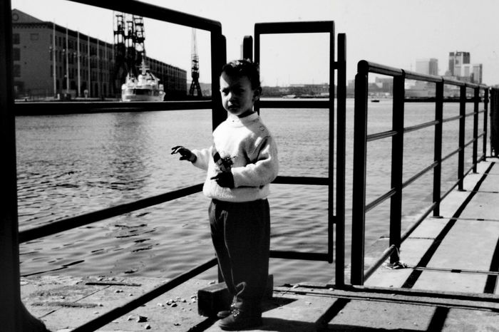Full Length One Person Water Childhood Child Outdoors River Day Children Only People Standing Real People Bridge - Man Made Structure Sky City Adult Blackandwhite Photography Monocrome