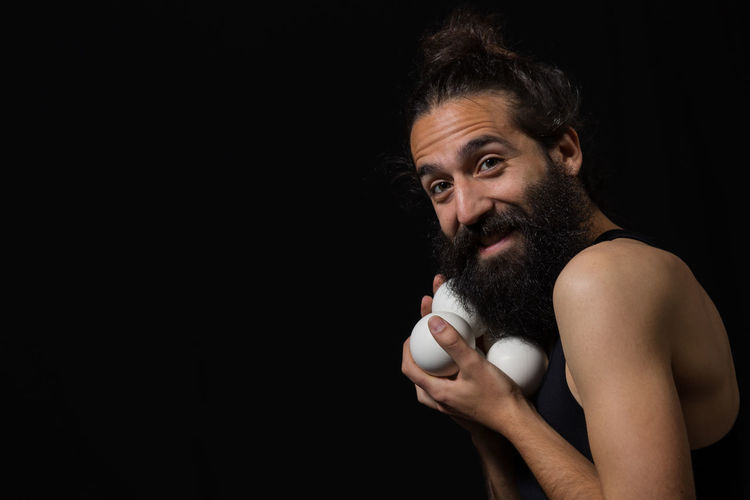 Juggler having fun at the circus Adult Black Background Circus Fun Happy Juggle Man Show Stage Acrobatics  Balls Beard Different Entertainment Juggler Juggling One Man Only One Person People Performance person Portrait Real People Scenics Studio Shot