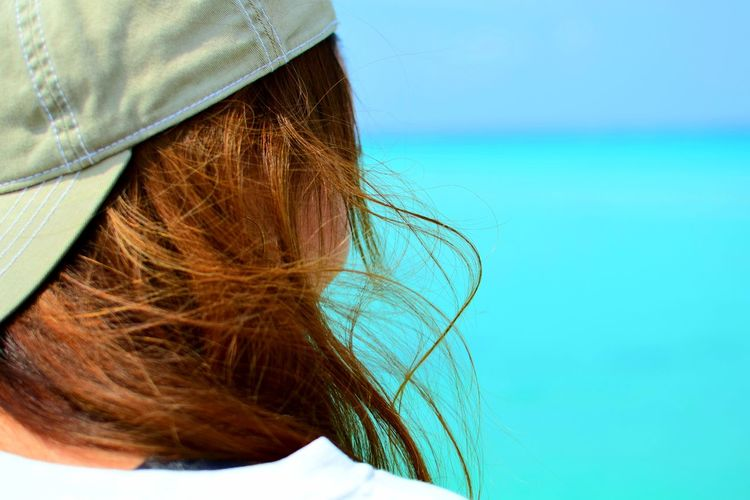Close-up of woman with blond hair looking at sea