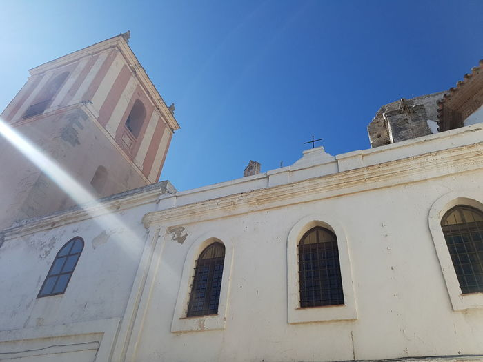 Building Exterior Architecture Built Structure Low Angle View Clear Sky Blue Outdoors Day Façade No People High Section History Spanish Culture Sunny Tarifa Tarifa Spain Historic Andalusia Old Town Sunlight Clear Sky Sun Spirituality Religion Church
