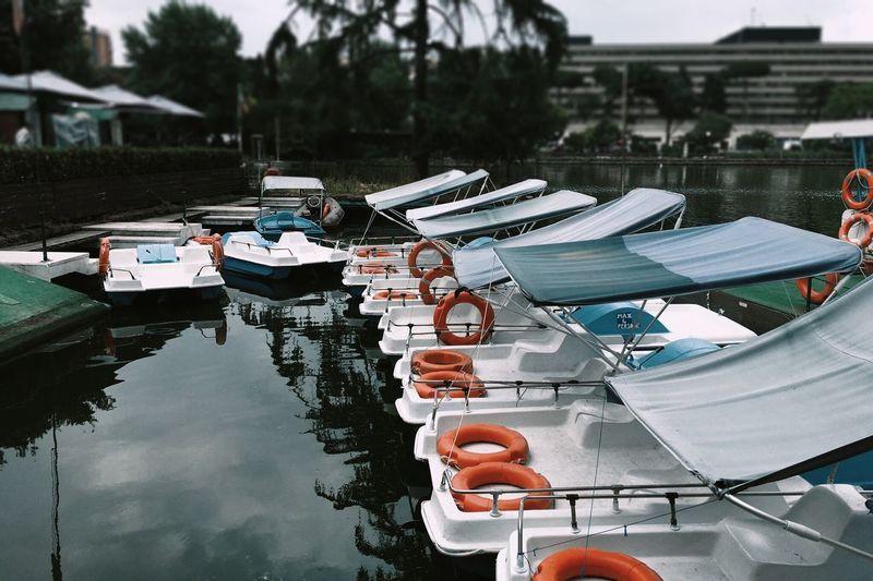 Boats moored at lake
